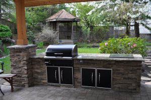 Cultured stone Traeger BBQ island with beverage cold well