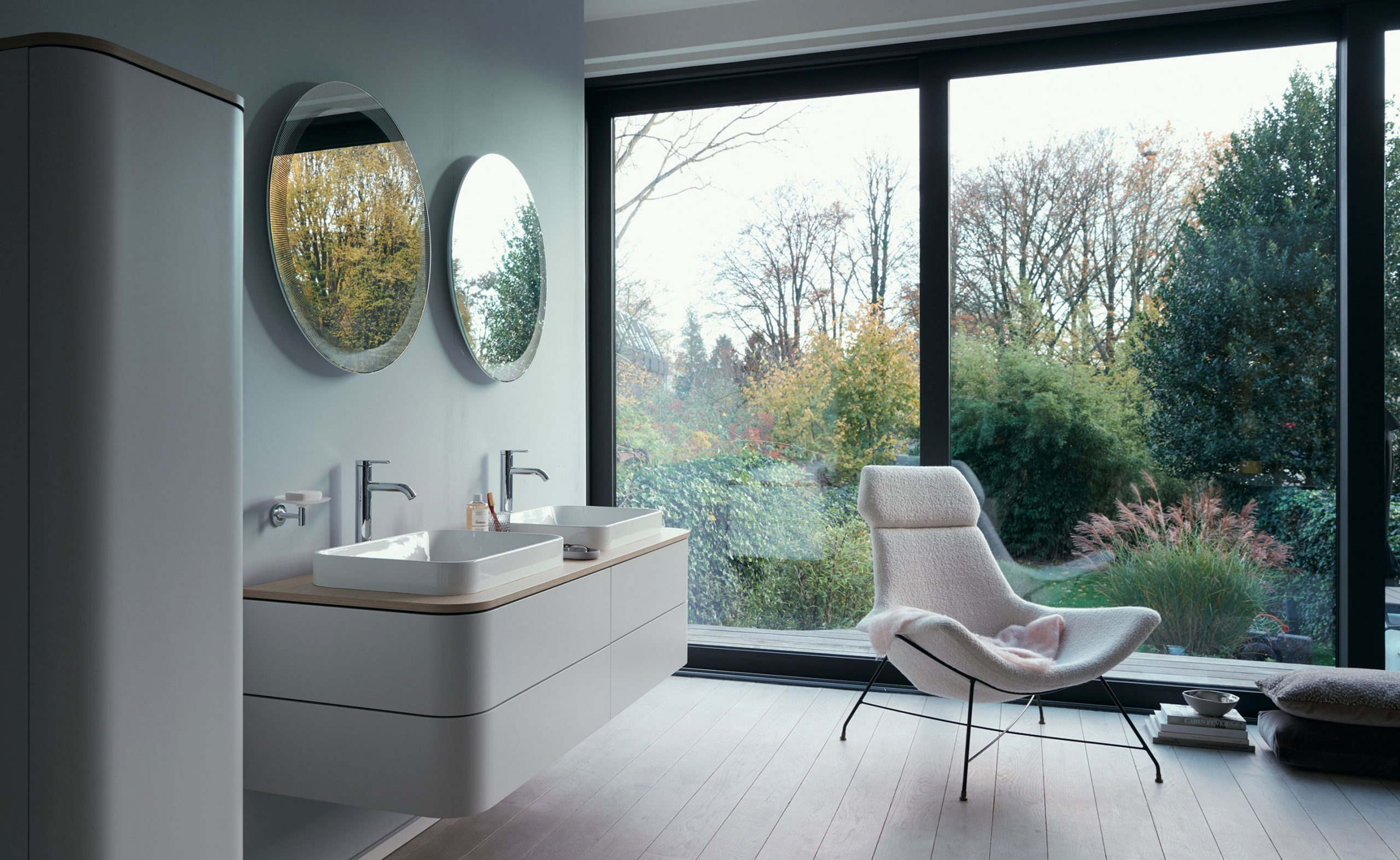 modern bathroom with large windows and outdoor view